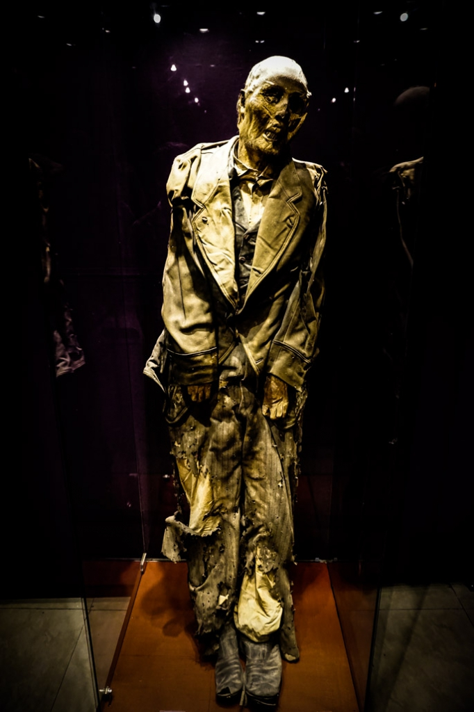 Mummy wearing the clothes he was buried in.