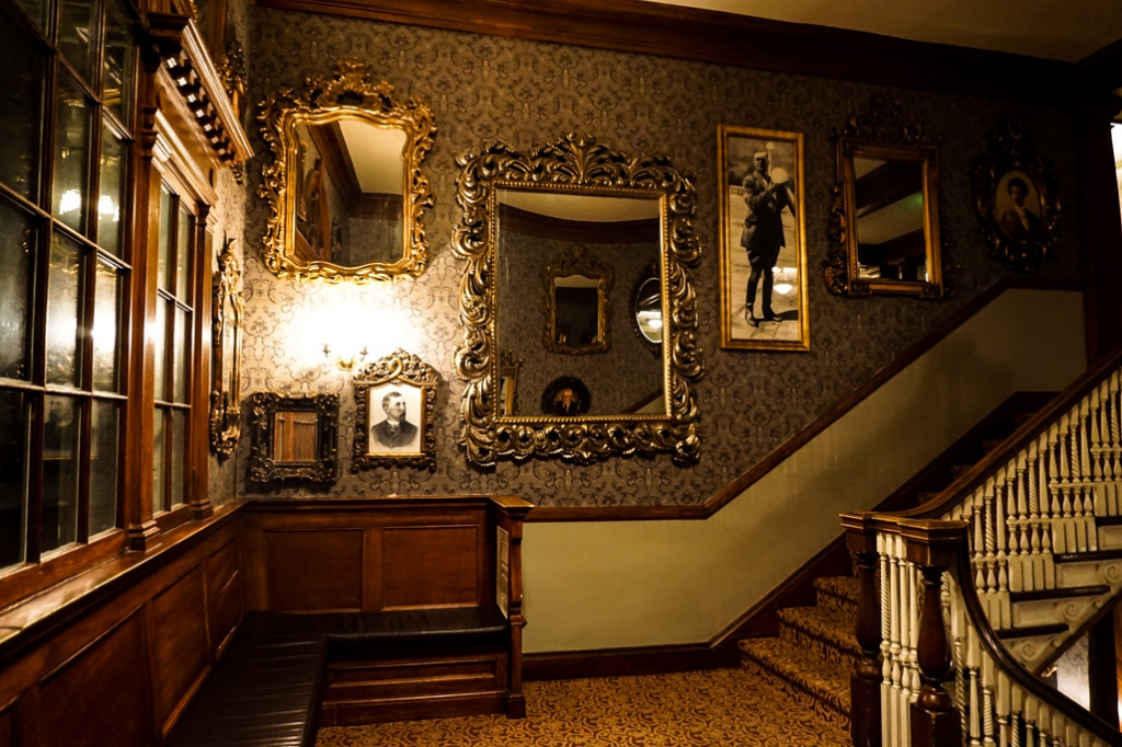 Pictures and mirrors on the main staircase of the Stanley Hotel.