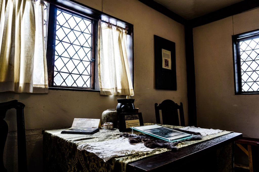 Window and table inside Witch House, Salem.