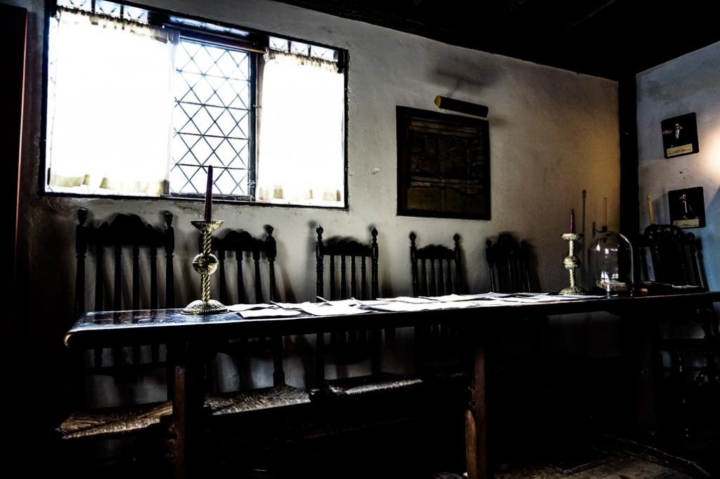 Table linked to Salem Witch Trials inside Witch House.