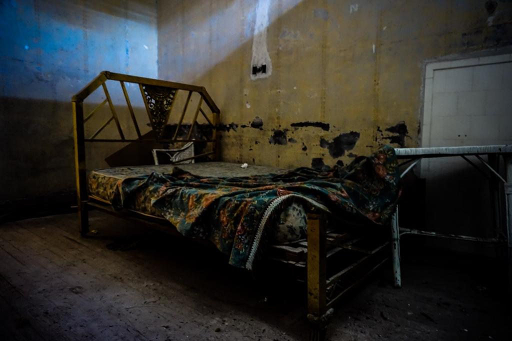 Abandoned bed in Eden Hotel.