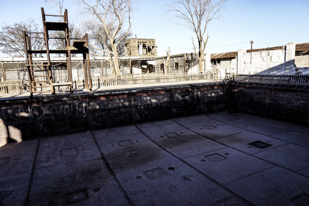 Drained, abandoned pool inside of Humberstone a haunted ghost town in Chile.