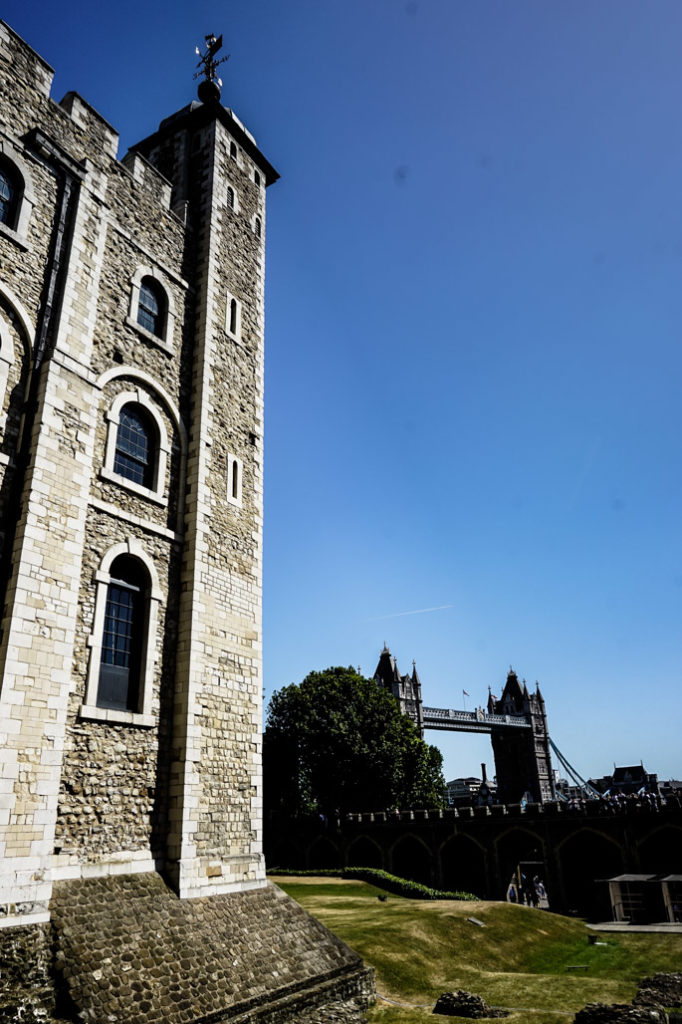 Tower of London with Tower Bridge in the background.