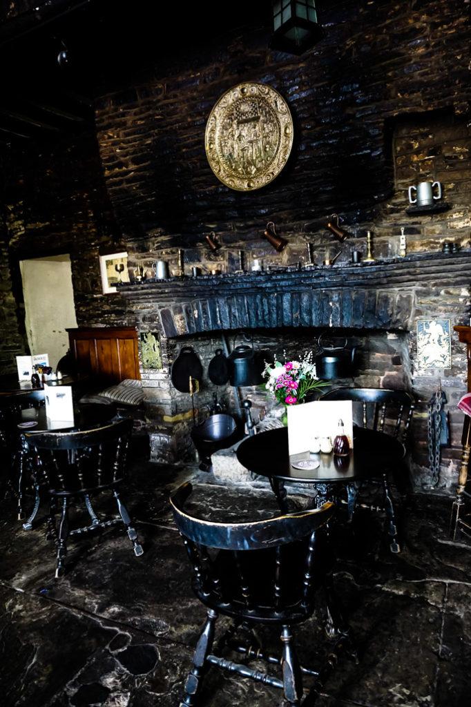 Fireplace in Haunted Skirrid Inn pub, South Wales.