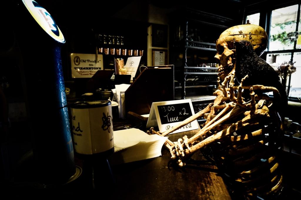 Skeleton at the bar inside Golden Fleece Inn.