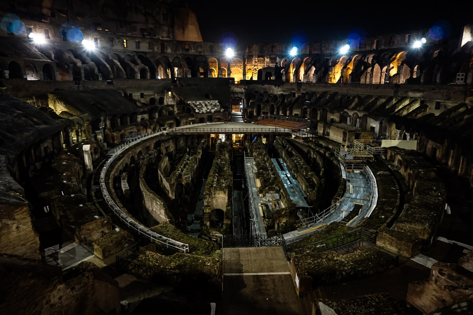 Inside the Roman Colosseum at night.