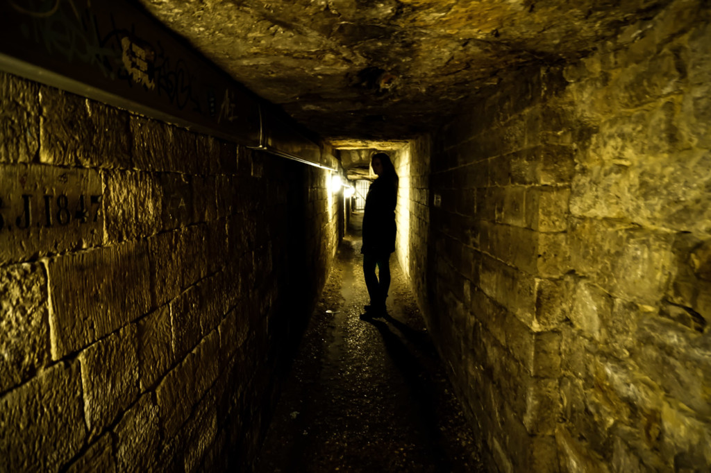 Dark Tunnels of the Catacombs of Paris.