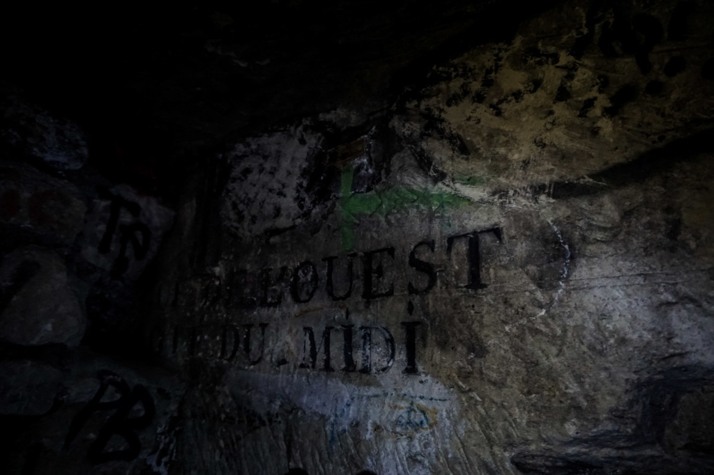 Street names written on the walls of the Paris Catacombs.