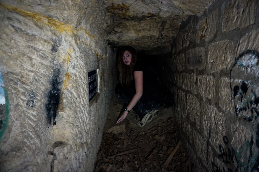 Small tunnel in the forbidden Paris Catacombs.