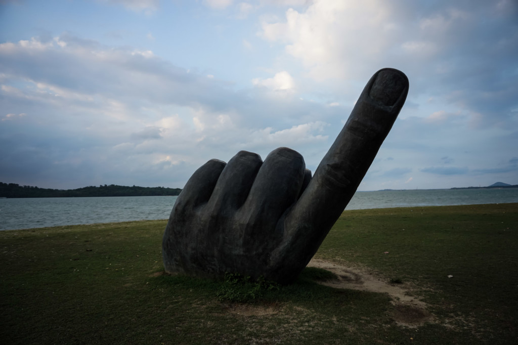 Hand sculpture on Changi Beach.