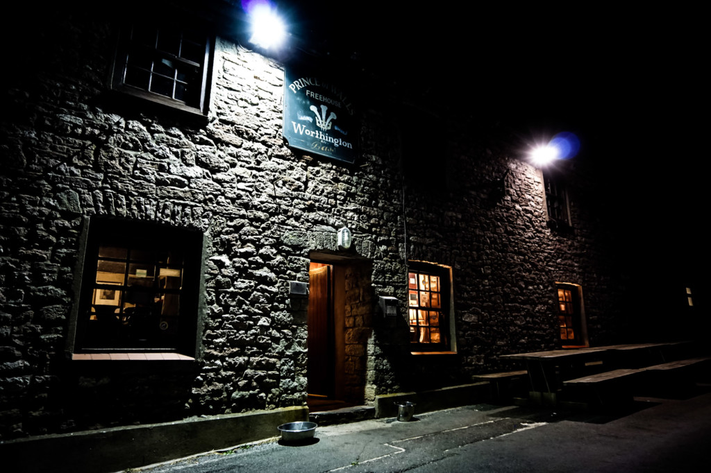 Prince of Wales Pub lit up at night.