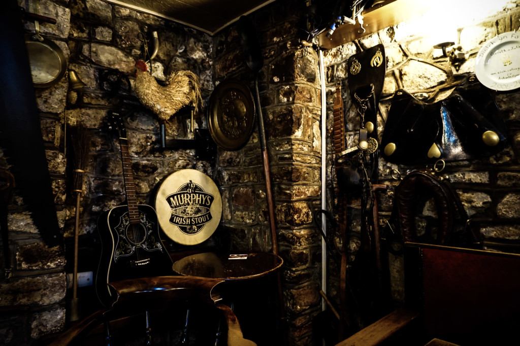 Decorated walls inside of the haunted Prince of Wales Inn.