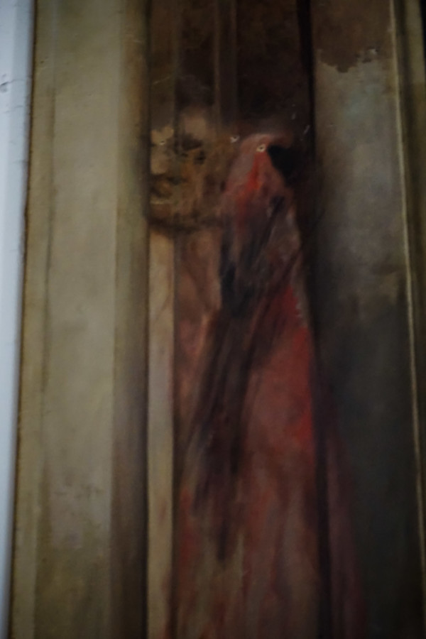 Demon face burnt onto walls of church.