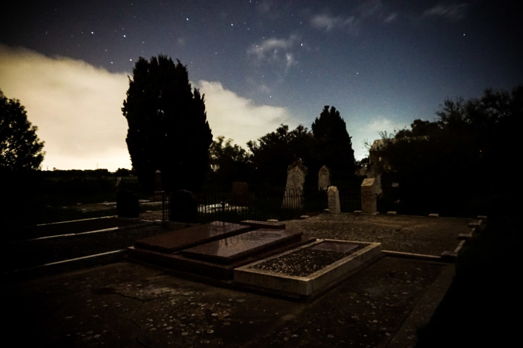 Stars and cemetery at night.