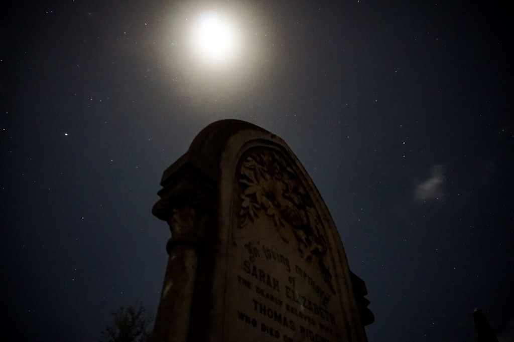 Full moon over Carclew Cemetery tombstone.
