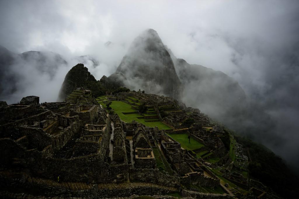 Heavy fog lingering over Machu Picchu, Peru.