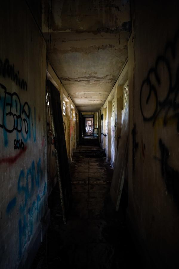Dark hallways in the ruin of the mansion.
