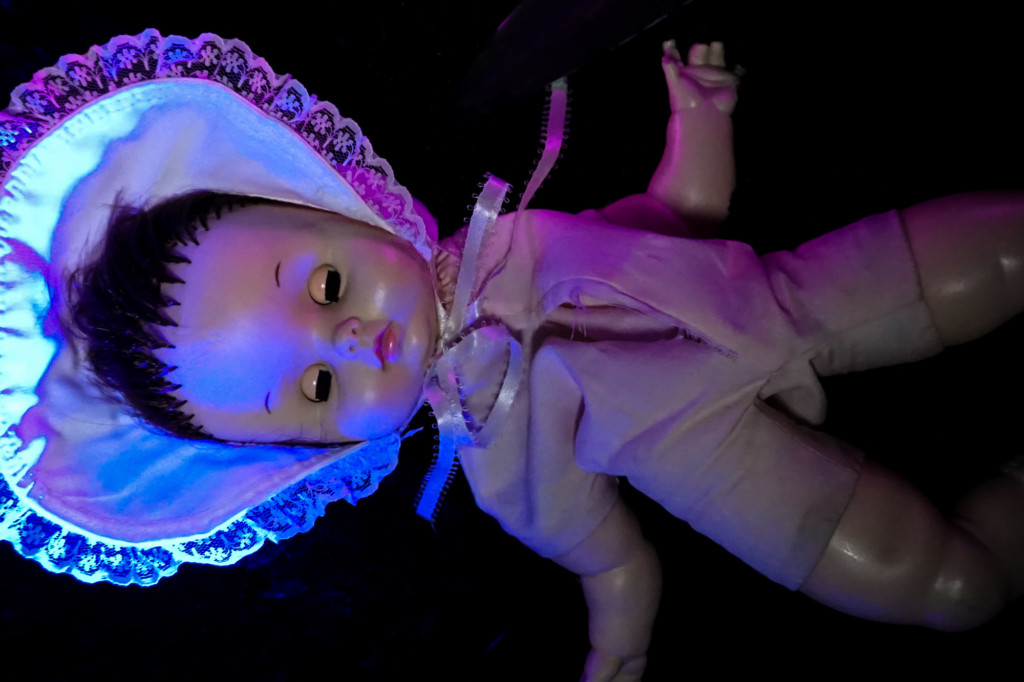 Cut open the doll for this paranormal ritual.
