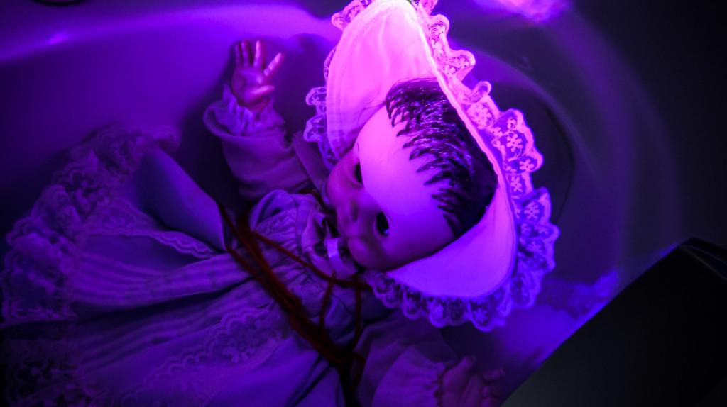 Doll in bathtub or sink for Hide and Seek Alone.
