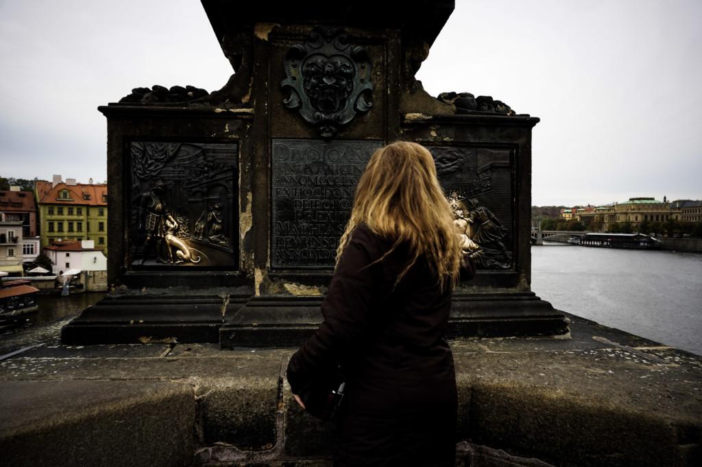Rubbing statues in Prague.
