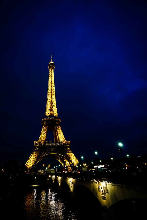 Eiffel tower lit up at night.